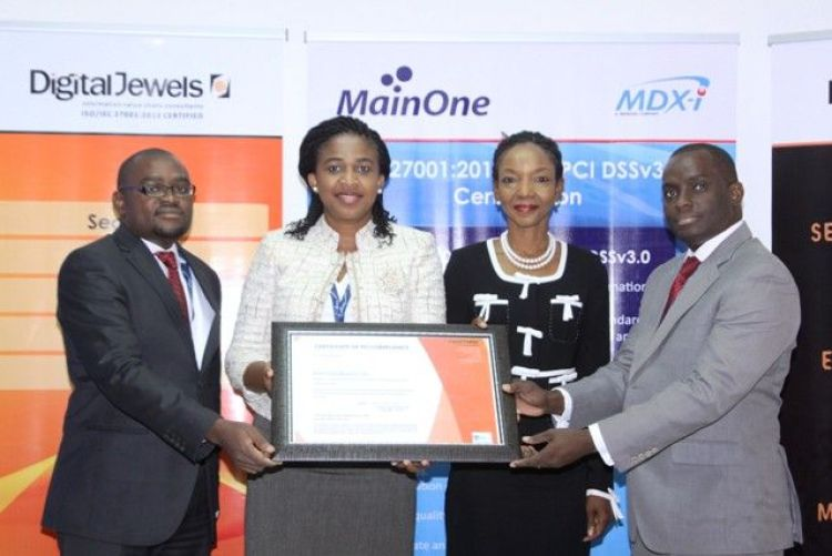Adedoyin Odunfa, MD/CEO, Digital Jewels (2nd Right), flanked by Chidinma Iwe, Chief Information Security Officer, MainOne (L); Lynda Madu, General Manager, Corporate Services & Development, MainOne and Akintunde Adekoya, Information Security Management Systems Manager, MainOne (R), during the presentation of ISO 27001 and PCI DSS certificates to MainOne's Data Center subsidiary, MDX-I in Lagos.