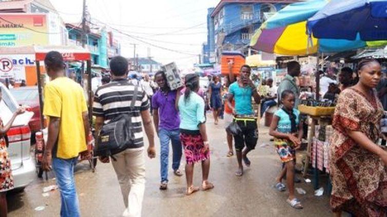 People walk by in Ikeja Computer Village, Nigeria's largest technology market cluster. Photo: Kolade Akinola/Technology Times