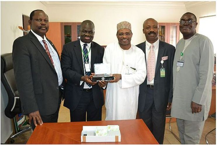 August 2014 file photo during the deliver of Nigeria's first National ID Card by Epayplau shows Barr. Chris E. Onyemenam, DG/CEO NIMC (left); Mr. Bayo Adeokun, Electronic Payplus Limited; Engr. Aliyu A. Aziz, Director IT/ ID Database NIMC and Mr. Ben Alofoje, Assistant Director Research & Strategy NIMC. Photo credit: Epayplus