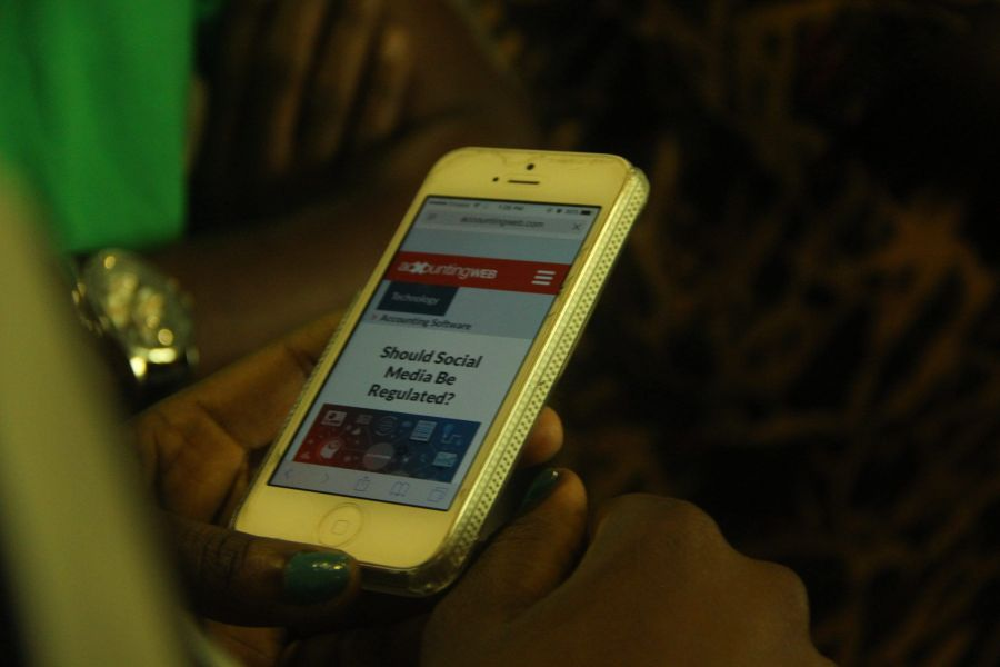 A mobile phone user seen at the Lagos Social Media Week