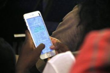 A mobile phone user seen chatting at a tech event