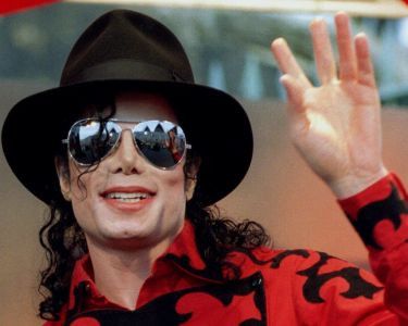 File photo of Michael Jackson waving to the crowd, numbering a few thousand, gathered in front of the Sydney Opera House