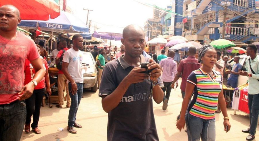 A phone user seen at the busy Ikeja Computer Village, Ikeja