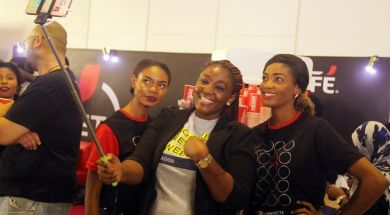 A mobie phone user seeing taking selfie at Social Media Week Lagos held recently in Nigeria. Photo credit: Kehinde Shonola of Technology Times