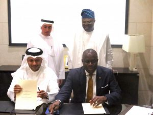 Lagos State photo release shows the signing of the Memorandum of Understanding for the Lagos Smart City that was on Monday signed at the Emirate Towers in Dubai by Mr. Adeniji Kazeem, Lagos State Attorney General and Commissioner of Justice (sitting left) and Mr. Jabber Bin Hafez, the Chief Executive Officer of Smart City Dubai LLC. Standing behind them is His Excellency, Ahmad Bin Byat, Chairman of Dubai Holdings, who is also the Deputy Prime Minister and Mr. Akinwunmi Ambode, Lagos State Governor.