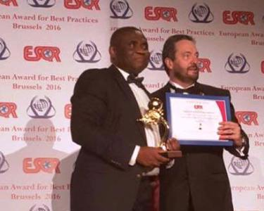 Tony Ojobo, Director Public Affairs receiving the award on behalf of the Commission