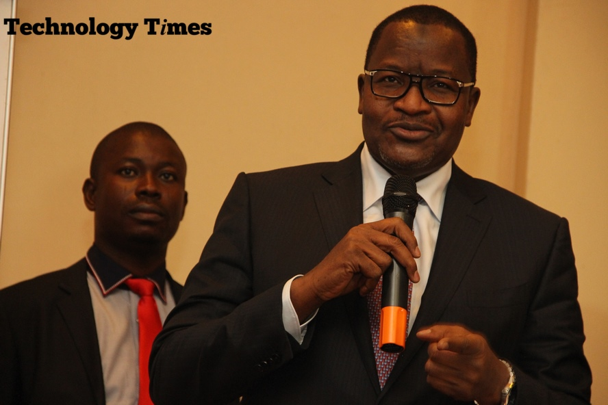 Professor Umar Danbatta, Executive Vice Chairman/Chief Executive of Nigerian Communications Commission (NCC), seen in photo holding microphone wants NATCOMS, the consortium led by businessman, Tunde Ayeni that bought the Nigerian Telecommunications Limited (NITEL) to pay funds running into billions said to have been waived by ex-President Goodluck Jonathan administration to pave way for the purchase of NITEL, later renamed Ntel