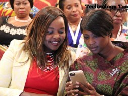 Technology Times photo shows two women looking at a mobile phone at the Africa Women Innovation and Entrepreneurship Forum (AWIEF 2016) held last week in Lagos