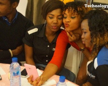 People seen taking selfie on a mobile phone at a smartphone launch event in Lagos
