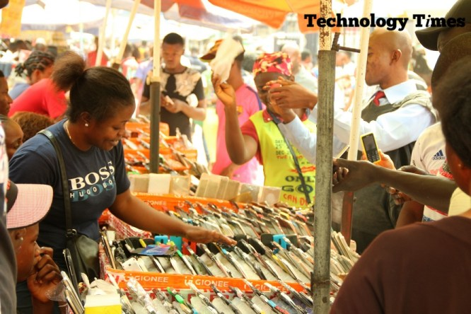 Technology Times file photo shows people seen buying and selling at Computer Village, Nigeria's largest technology market.