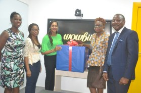 Head of ICT, RiverBank School, Adetutu Arueyingho (left); Head of School, RiverBank School, Regina Jemide; receiving the certification plaque from the CEO, Wowbii Interactive, Terae Onyeje and the Managing Director, Equipment Hall, Gbolahan Olayemi, during the formal certification of RiverBank School as a BuddZone, an interactive learning environment, by Wowbii Interactive, recently in Lagos.