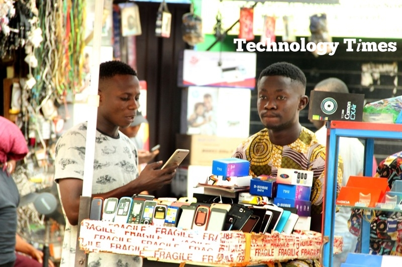 Mobile phone sellers seen at Ikeja Computer Village, Nigeria's biggest technology market hub located in Lagos, Nigeria.