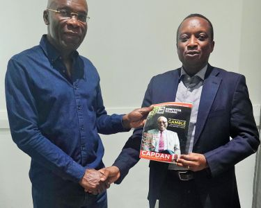 Chief Leonard Nnamdi Ekeh, Chairman of Zinox Technologies (left) and Mr Shina Badaru, Founder of Technology Times Media Limited, presents a copy of Komputer Village Magazine to Ekeh during a courtesy visit to the Zinox Chairman.
