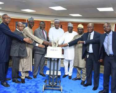 Professor Umar Garba Danbatta, Executive Vice Chairman and Chief Executive, NCC, middle, and some of the retiring officials cut the cake at the valedictory ceremony held at the NCC headquarters in Abuja.