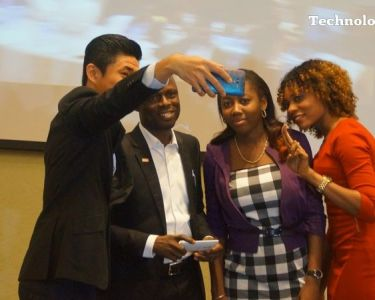 People seen taking selfie at a mobile phone launch in Lagos