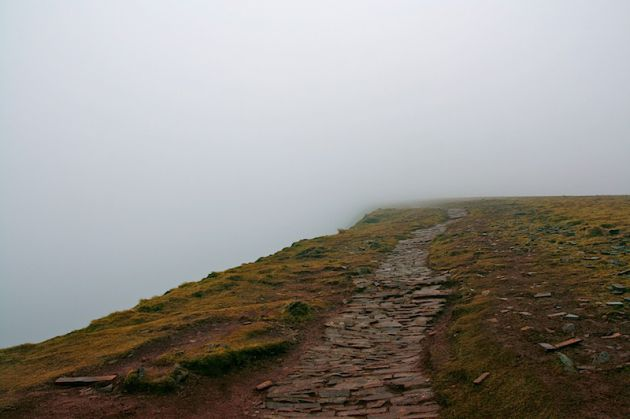 Walking up Pen y Fan into the clouds