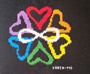 six colored hearts surrounding a white infinity symbol