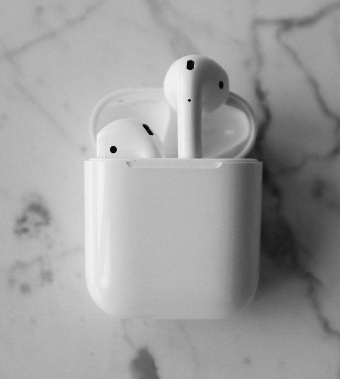 monochrome photo of apple airpods