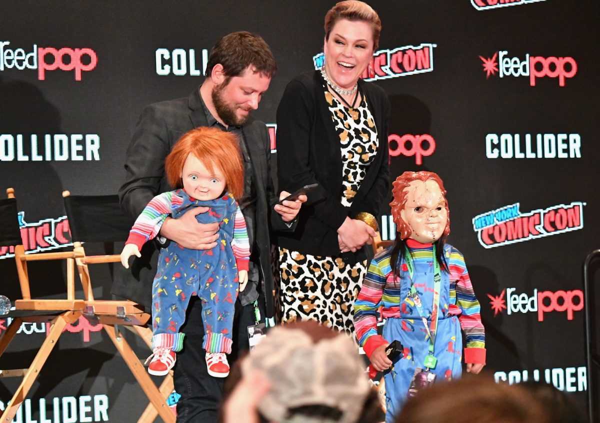 Alex Vincent and Christine Elise pose with a Chucky cosplayer