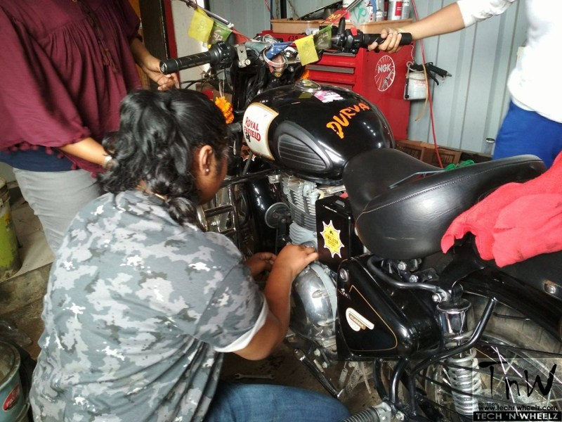 The Bikerni learns how to tight the nut @ TnW's DIY motorcycle repair workshop
