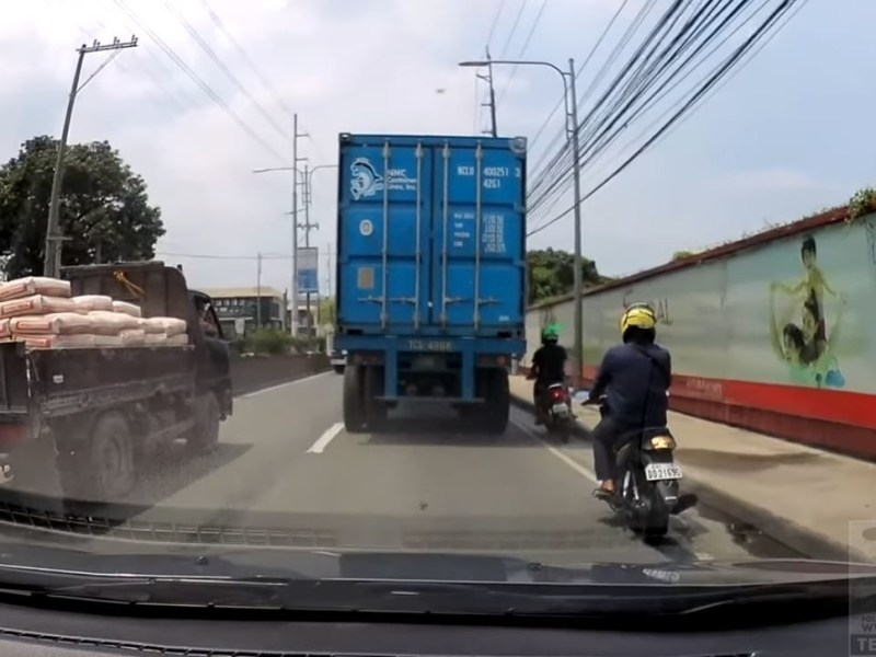 Helmet saves rider's life as heavy truck runs over his head