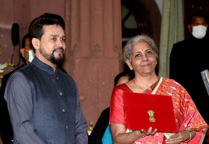 The Union Minister for Finance and Corporate Affairs, Nirmala Sitharaman along with the Minister of State for Finance and Corporate Affairs, Anurag Singh Thakur arrives at Parliament House to present the General Budget 2021-22. (Photo: PIB)