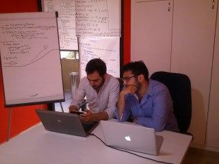 Co-founders Cedric Maalouf (l) and Rakan Nimer brainstorm in their co-working space, located in Soufi, Ashrafiyeh. (Photo by Osman Kudsi)