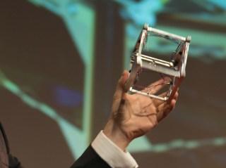 The author display a Nanosatisfi CubeSat.