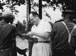 The Tuskegee syphilis experiment helped lead to new ways to protect subjects of scientific studies. Now those controls may be outdated. (Here a researcher draws blood from a subject.) (Photo copyright National Archives and Records Admin.)