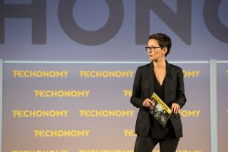 """Simone Ross onstage at TE15. She co-wrote this essay to illustrate how tech might help in """"Rehumanizing Society,"""" which was the conference theme."""