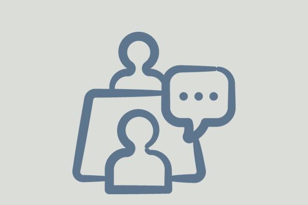 icon of two people sitting acros of each other with a speech bubble
