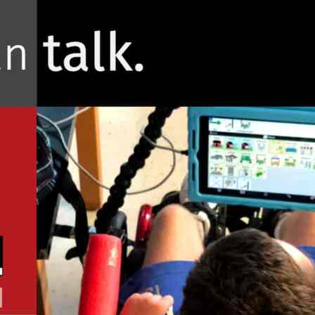 "Photo with words ""I can talk"" and a person using a tablet to communicate."
