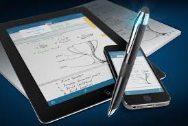 Pen with paper, tablet and smartphone