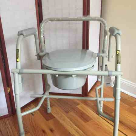 Metal framed commode chair.