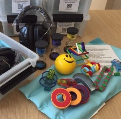 Assortment of fidgets including a stress ball and slinky.