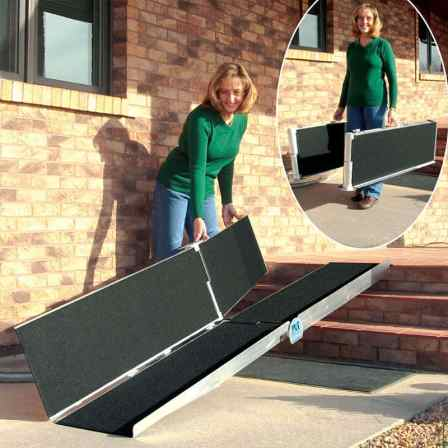 Woman unfolds a portable suitcase ramp over brick steps.