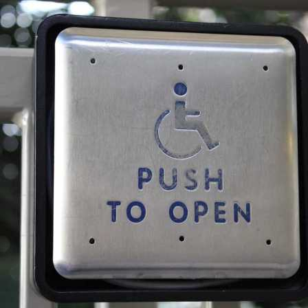 Push plate to open an accessible door.