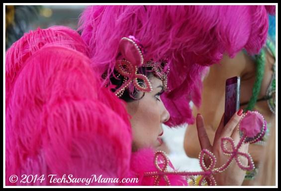 Samba dancer takes photos