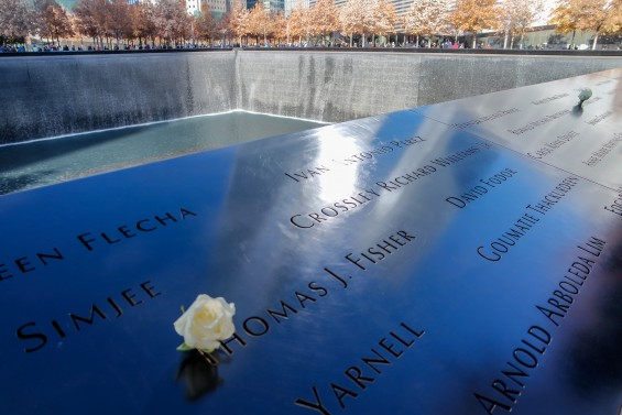 A white rose placed on a name signfies the birthday of an individual who died on 9/11 © 2014, Leticia Barr All Rights Reserved
