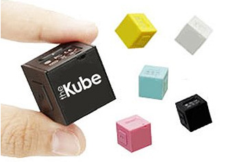 The Kube MP3 player, shown in the hand