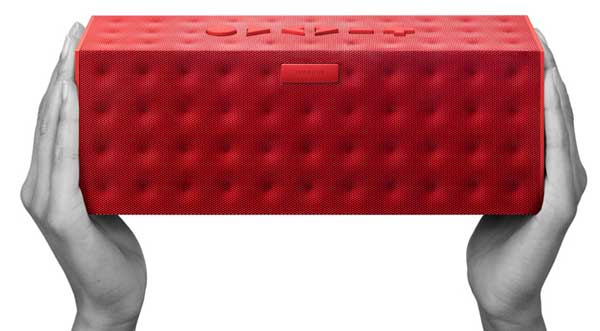 Big Jambox wireless speaker, in red, in hands