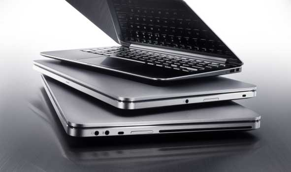 Silver Dell XPS laptops, the XPS 13, XPS 14 and XPS 15, in a stack