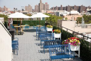MEET on Bowery Roof with umbrellas
