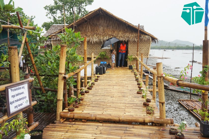 A photo of a short bamboo bridge leading to a bamboo hut.  This Photo was taken during our Capture Capiz and Iloilo Tour.