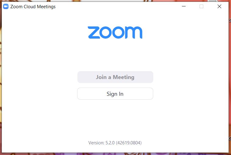 "A screenshot from the Zoom Cloud Meetings app on computer. Other than the zoom logo, it contains the words Join a Meeting and Sign In. This photo is for the ""How to Use Zoom"" blog of TechToGraphy."