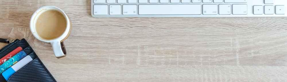 white apple keyboard near white cup