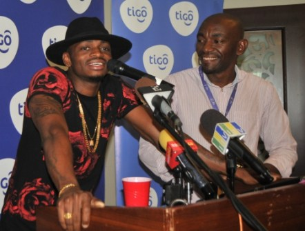 Award-winning vocalist Diamond Platnumz (left) shares his excitement for Tigo Music; the country's first mobile app that provides Tanzanians with unlimited access to music. To his left, Tigo Brand Manager, William Mpinga