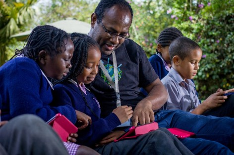 IBM Research Scientist, Dr Kommy Weldemariam with pupils from Riara School, Nairobi exploring how technology can help improve educational outcomes