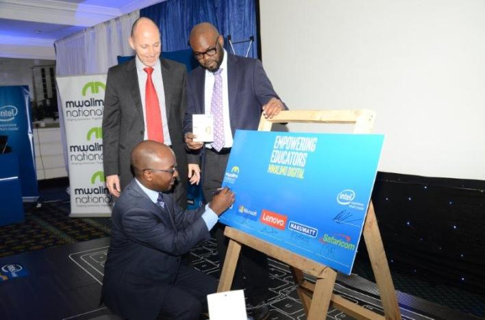 INTEL East Africa General Manager, Danie Steyn and Microsoft's General Manager for East Africa- Kunle Awosika look on as Mwalimu National Sacco CEO- Robert Shibutse signs the agreement.