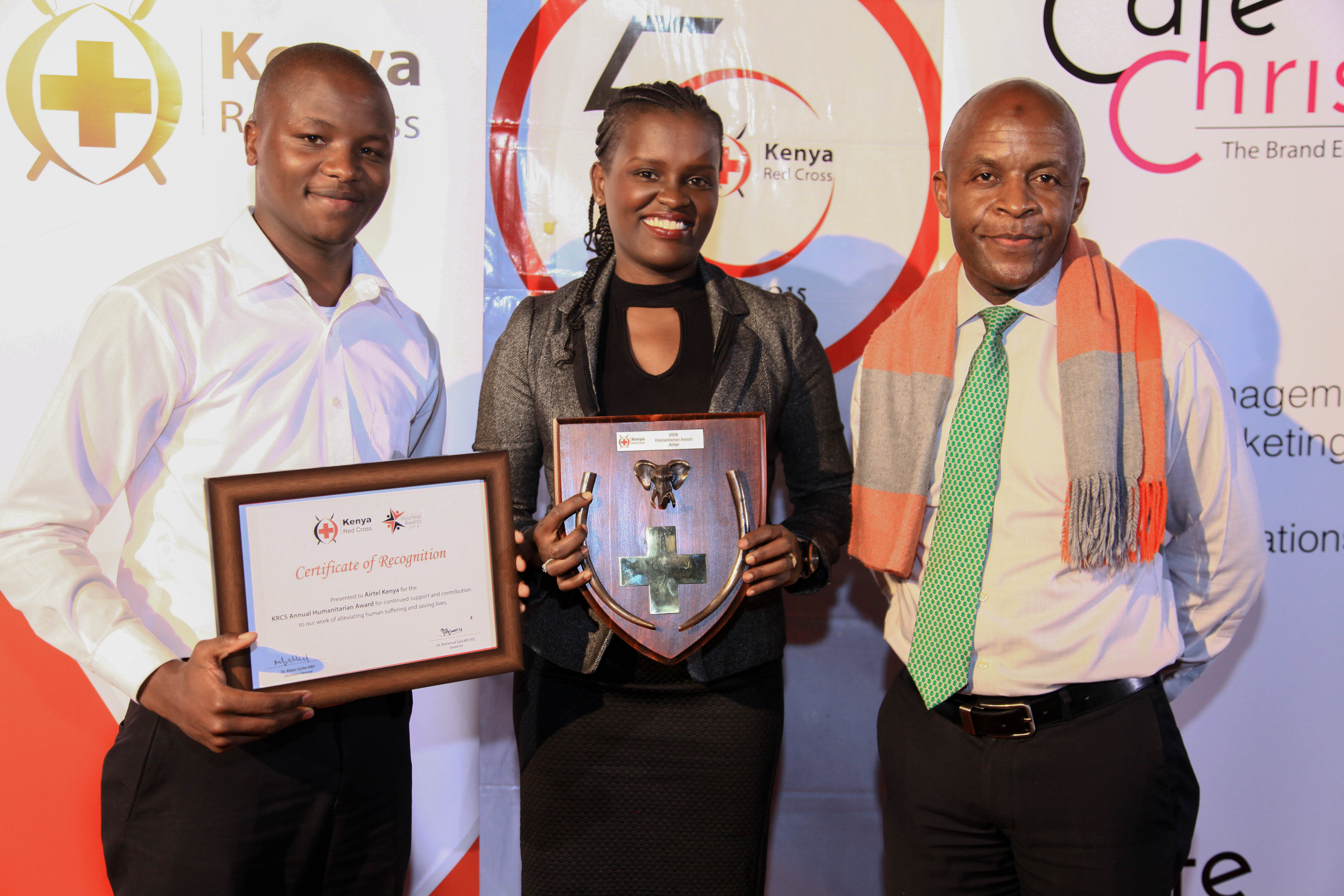From Left- Airtel Kenya's Communications Executive Jesse Kisenya and CSR Manager Aigeldel Kirumburu receive the Kenya Red Cross Annual Humanitarian Award from IFRC Gender Coodinator Nkhoma Potipher.